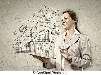 Young woman with ipad in hands - Image of young woman...