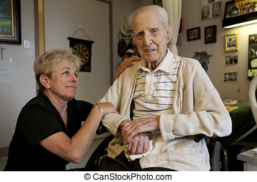 Daughter visiting Dad at Long Term Care Facility - A loving...
