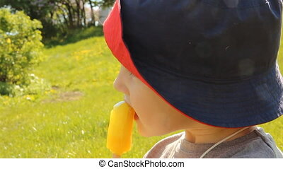 A little boy eating ice cream in a