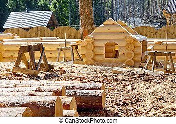 Construction plaschadka processing and assembly log cabins...