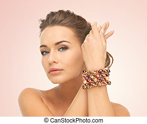 woman wearing bracelet with beads - beautiful woman wearing...