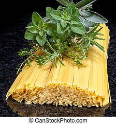 Uncooked Pasta with Fresh Herbs - Uncooked fettucine pasta,...