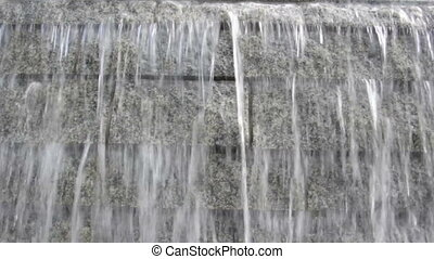 Water Fountain  - Steady flow of water over rock face.