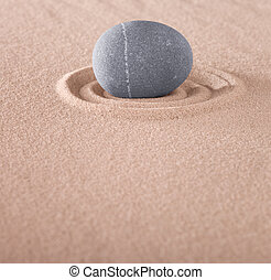 zen meditation stone on circle in sand. Japanese sand garden...