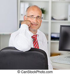 Confident Businessman rest on chin - Portrait of confident...