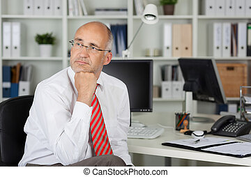 employee looking to side in thought - employee with hand on...