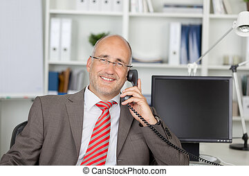 relaxed businessman calling by phone