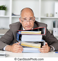 too much work - overworked businessmann leaning head on a...