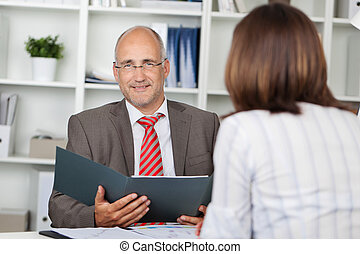 businessman and woman in interview - businessman holding cv,...