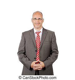 confident businessman, portrait waist-up in studio