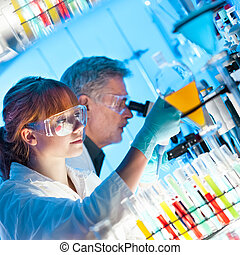 Health care professionals working in laboratory - Attractive...