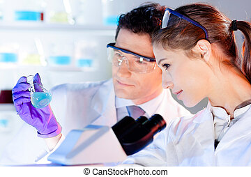 Health care professionals working in laboratory. - Chemical...