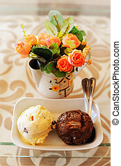 Close up of icecream with flower on table.