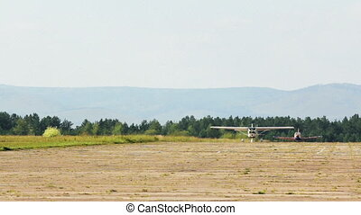 Two planes taxiing on runway
