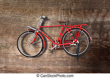 red bicycle - vintage red bicycle on wood background