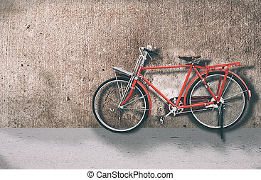 red bicycle - red vintage bicycle on the concrete wall...