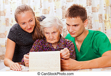 Elderly woman with the sweet young doctors - Elderly woman...