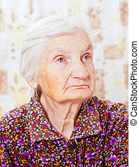 Closeup of a beautiful retired senior happy woman - Closeup...