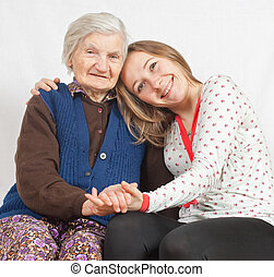 The sweet young girl and the old woman staying together -...