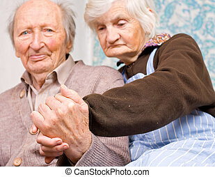 Quietness - Old happy grandparents staying together