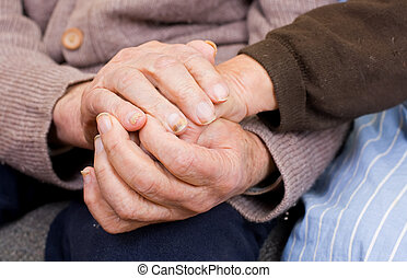 Quietude - Old couple holding the hands