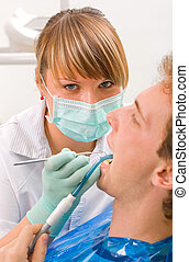 Sweet young dentist - Young man at the sweet dentist