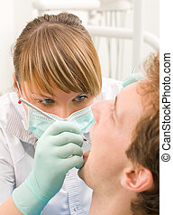Young dentist - Young man at the sweet dentist