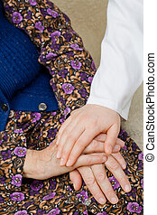 Repose - The doctor holding an elderly woman's hand.