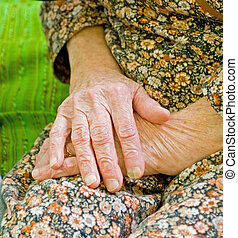 Holding hands - Old lady staying alone at home whit holding...