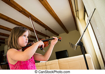 Child playing violin - Child (little girl) playing violin...
