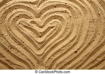 yellow sand texture (heart) as summer background