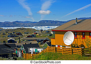 Jet Trails over Narsaq, Greenland - View of sky and the town...