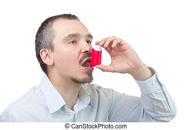 Asthma medication. - Caucasian male inhaling aerosol spray...