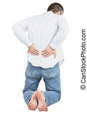 Back problem. - Adult caucasian male rubbing back standing...