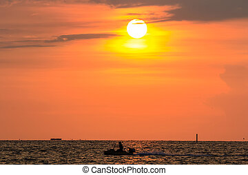 Jet-Skier and sunset at Bangsaen , Chonburi, Thailand -...