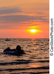 Jet-Skie and sunset at Bangsaen , Chonburi, Thailand -...