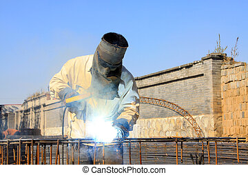 professional worker welding operation in construction industry