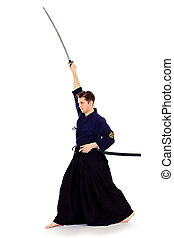 asian style - Handsome young man practicing kendo. Isolated...