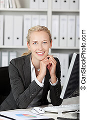 Smiling Young Businesswoman With Hands On Chin - Portrait of...
