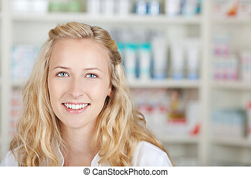 Portrait Of A Female Pharmacist At Pharmacy - Portrait of a...