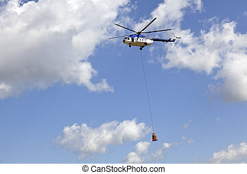 cargo helicopter - helicopter in the air carrying a human...