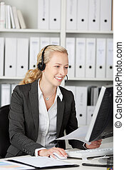 Blond Customer Service Executive Using Headset