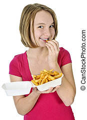 Teenage girl with french fries - Teenage eating french fries...