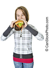 Teenage girl eating big hamburger - Teenage girl eating a...