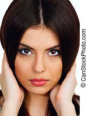 Closeup portrait of a Young beautiful woman touching her...