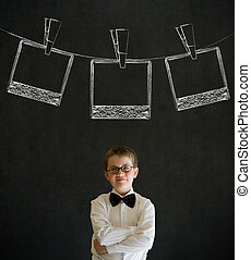Thinking boy business man with hanging instant photo...