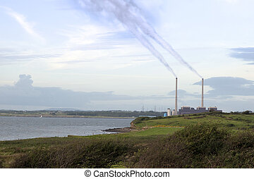 fumes billowing from the power plant chimney stacks