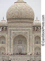 Tourists at the Taj Mahal - Taj Mahal. Mughal style ornate...