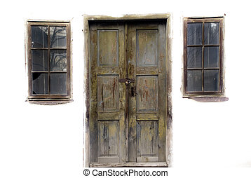 Entrance - Door and two windows on an old abandoned house