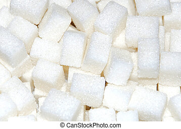 sugar cubes - a close up of a sugar cubes